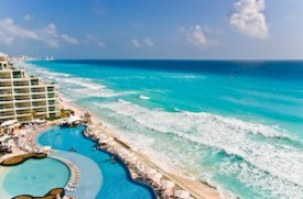 Mexico Cancun beach with turquoise sea and hotel