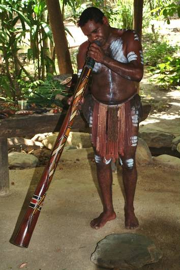 Aborigines playing a didgeridoo
