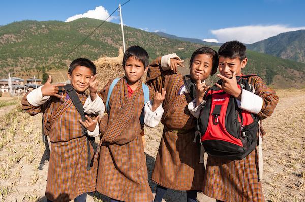 Happy children in Bhutan - image by gnohz/shutterstock.com