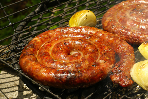 Boerewors shaped as roll on grill