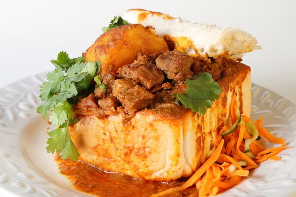 Typical South African food: bunny chow - curry in a holed-out bread
