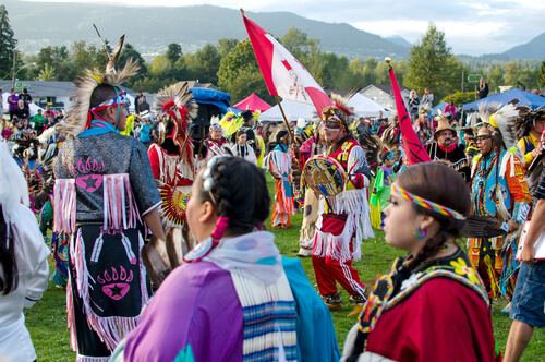 Canada First Nations people celebrating pow wow - image by Anton Bielousov/Shutterstock.com