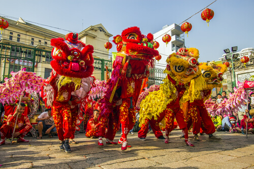 Lunar new year's dragon dance in Vietnam - image by Saigoneer/shutterstock.com