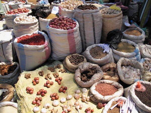 Comoros Facts: Spices sold in the market - image by AltrendoImages/shutterstock.com
