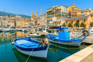 Corsica fishing boats in harbour - image by shutterstock
