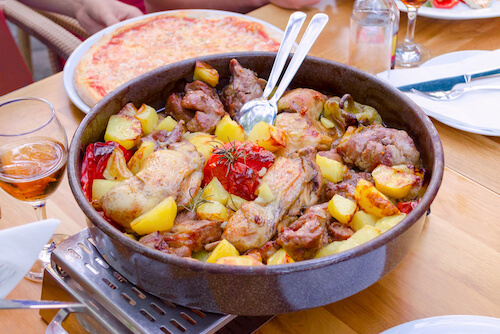 Croatian Peka of mixed meats and vegetables - image by Nadisja/shutterstock