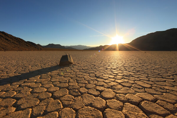 Death Valley sun over dry sand