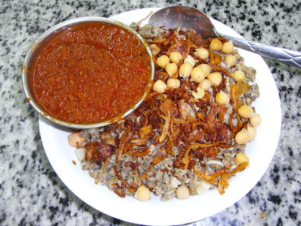 Kushari - Egyptian national dish - served in an Egyptian restaurant in Cairo - image by shutterstock