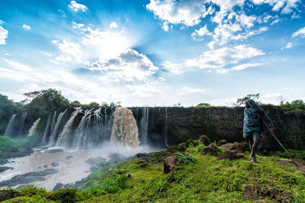 Blue Nile Falls with boy - image by Craig Schuler/shutterstock.com