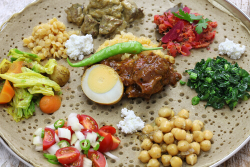 Ethiopian food - injera with different vegetable sauces