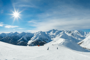 German Alps in snow with skiers