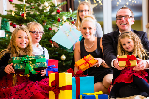 German family exchanging gifts on Christmas