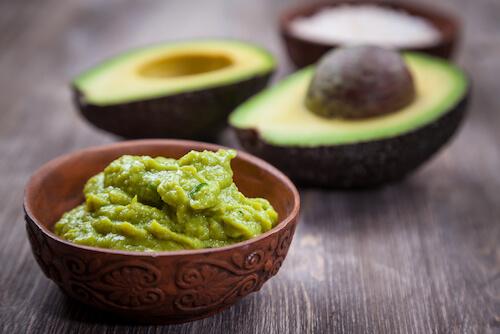 avocado and guacamole in a dish