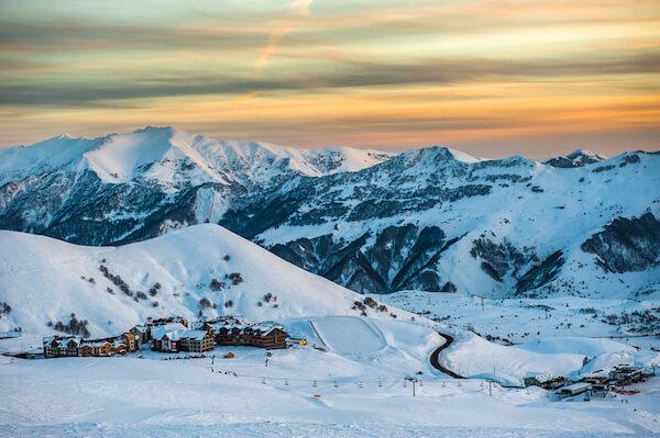 Gudauri ski resort with snow at sunset - image shutter stock.com