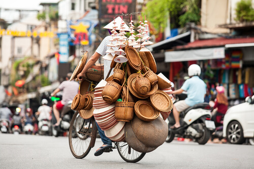 Street vendor on bike in Hanoi's Old Quarter - image by Tony Duy/Shutterstock.com