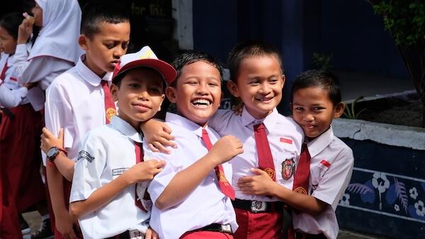 Indonesian pupils in school uniform - image by Casa Nayafana/shutterstock.com