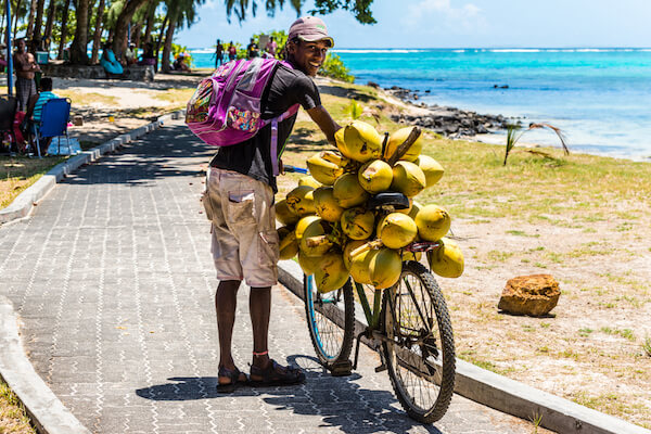 Mauritius Coconut Vendor at the Beach - image by Bivalent/shutterstock.com