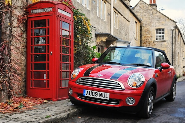 UK symbols: Minicooper and telephone booth - image by 1000Words/shutterstock.com