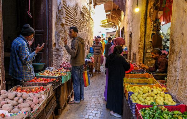 Fruit vendors in the Fez medina - image by Dino Geromella