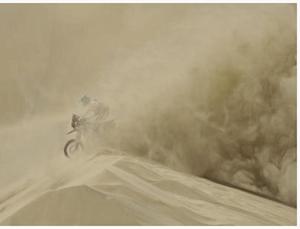 Dakar rally motobiker in sandstorm -image by dpa