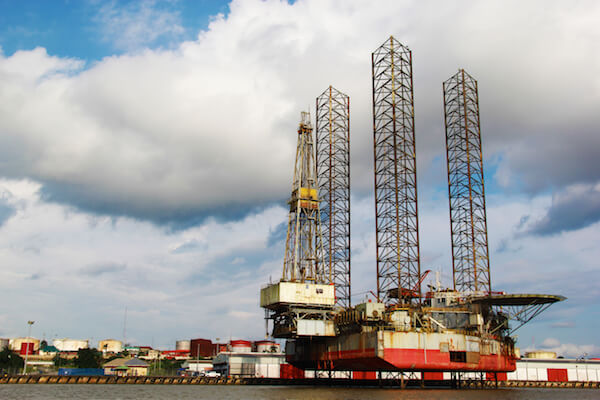 Oil rig in Nigeria - image by Theo Inspiro International/shutterstock.com