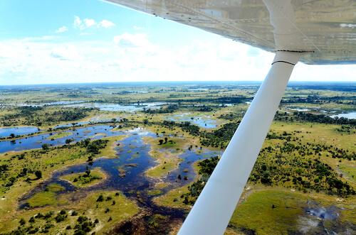 Aircraft flying over Okavango Delta in Africa