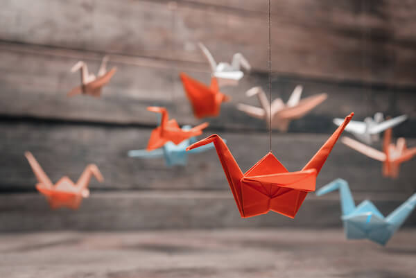 Pink and red origami paper cranes
