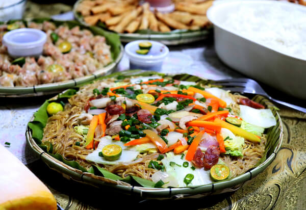 Typical Filipino dishes including pancit or pansit which is a fried noodle dish