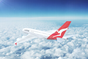 Quantas airplane in the sky - image by Nextnewmedia/shutterstock.com