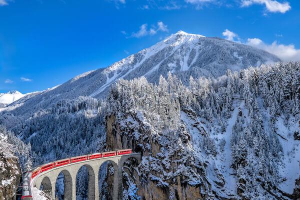 Switzerland Glacier Express in winter with blue sky