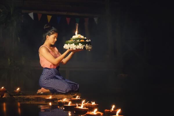 Girl at Loi Krathong festival with flower float