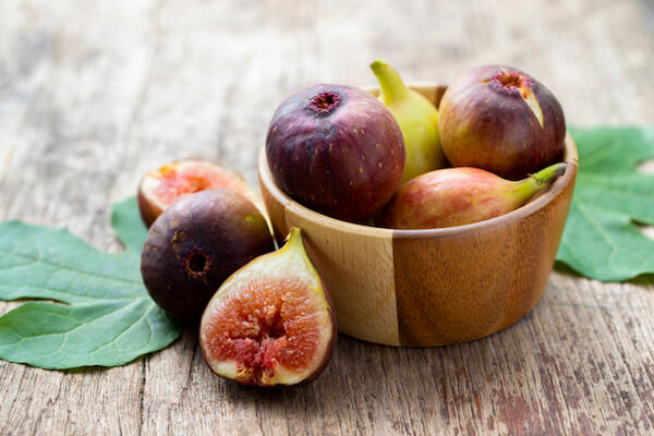 Turkish figs in wooden bowl
