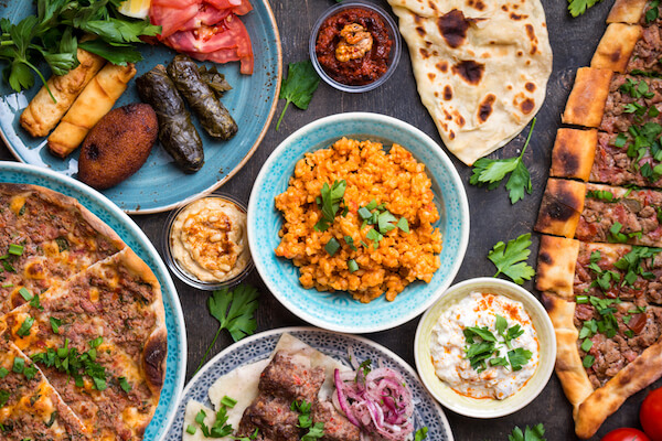 Typical dishes in the Turkish cuisine: Turkish pizza, meat kebab, pita, bulgur, fried meatballs, hummus and turkish meze set.