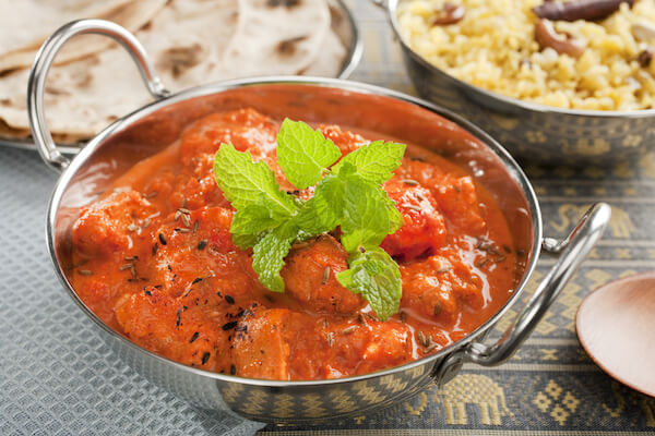 Chicken Tikka in balti dish with roti and rice