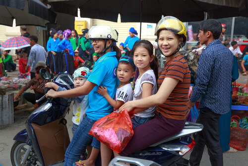 Vietnam family of 5 on a motorbike - image by Quang Nguyen Vinh/Shutterstock.com
