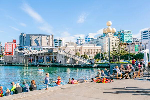 Wellington waterfront - weekend crowds relax on Wellington's inner city walkways. Credit: Hayden Bishop/TourismNewZealand