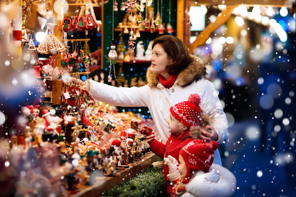 German Christmas market stall and mother with two children