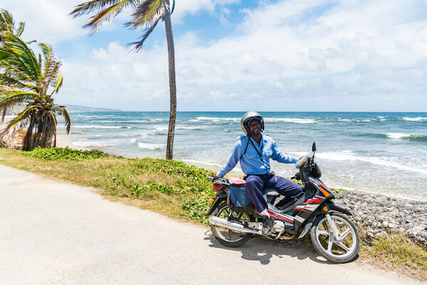 Barbados beach with motorbike - image by Stephanie Brannier/shutterstock.com