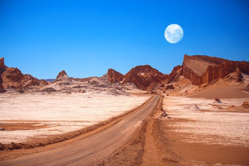 Moon over Moon valley in Atacama desert in Chile