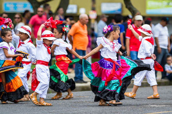 Costa Rican children dancing on Independence Day - image by Wollertz/shutterstock.com