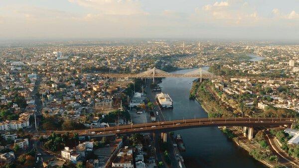 Santo Domingo is the Dominican Republic's capital city. The Ozama River runs through the city.