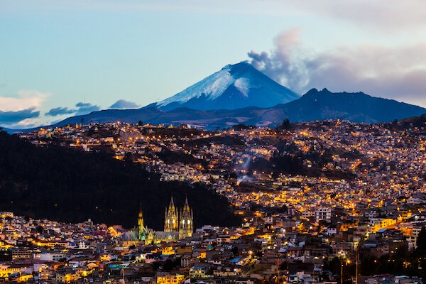 Quito, capital city of Ecuador with fuming Cotopaxi volcano in the background