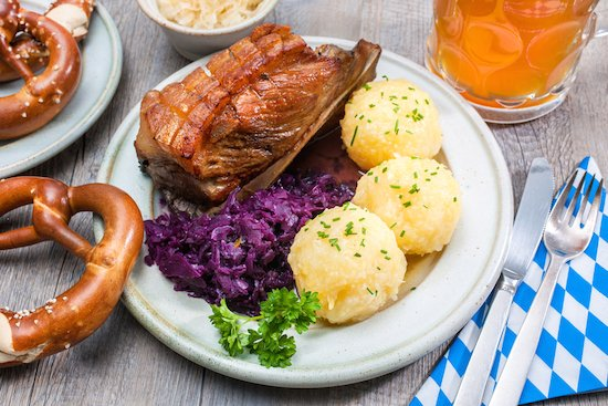 Typical German food: roast pork with red cabbage and knoedl (dumplings)