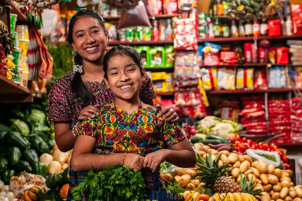 Two smiling Guatemalan women in shop