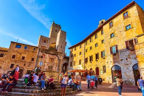 Piazza in San Gimignano in Italy - image by Nataliya Nazarova
