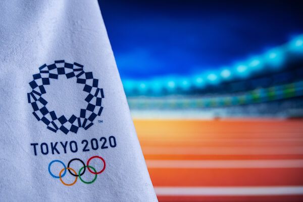 Tokyo Olympics Flag with logo - image by Krovop58/shutterstock.com