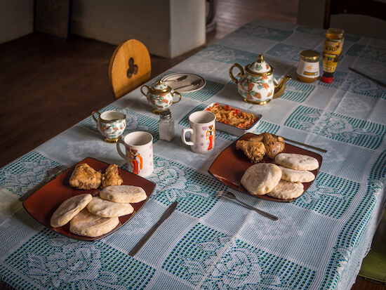 Typical breakfast with Basotho bread, chicken and tea - image by Fabia Plock/shutterstock.com