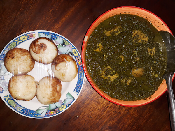 Traditional Malagasy meal: Mofogasy rice cakes and ravitoto