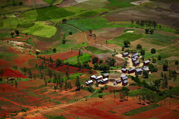 Malagasy village with typical red soil - Madagascar is often called the Great Red Island