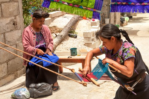 Mayan Women weaving_ image by Lena Wurm/shutterstock.com